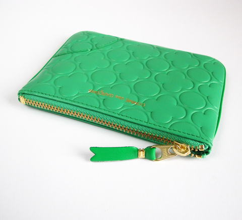 The Zip wallet in embossed green is a simple pouch in soft leather with ... click for more information