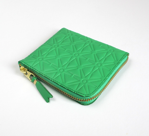 Available in a new pattern! The Zip Wallet in embossed green leather ope... click for more information