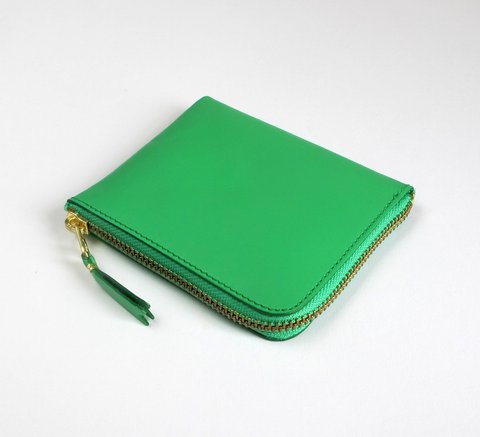 The Zip Wallet in classic green opens across two sides featuring a pocke... click for more information