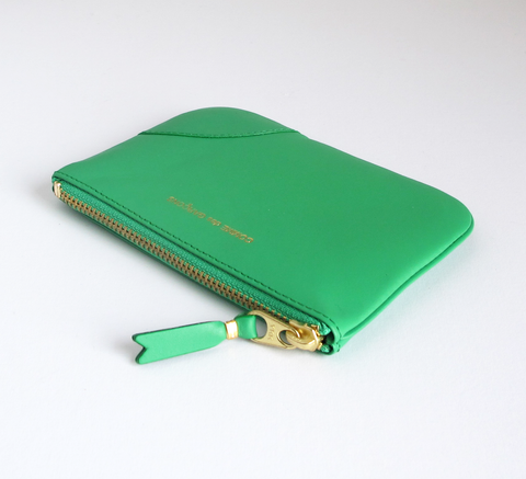 The Zip wallet in classic green is a simple pouch in soft leather with a... click for more information