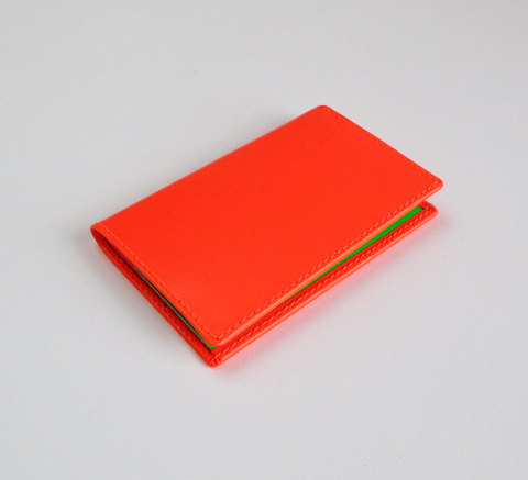 This card holder has a super fluro orange exterior and a pop of colour i... click for more information