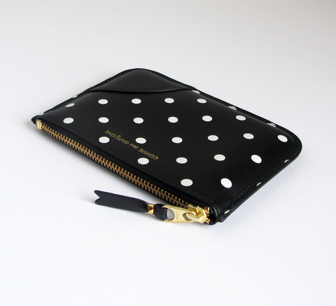 New in store the black and white polka dot zip wallet is a simple pouch ... click for more information