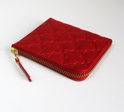 The Zip Wallet in embossed red leather opens across two sides featuring ... click for more information
