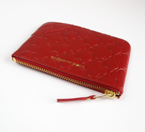 The Zip wallet in embossed red is a simple pouch in soft leather with a ... click for more information