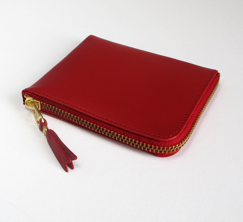 The Zip Wallet in plain red opens across two sides featuring a pocket in... click for more information