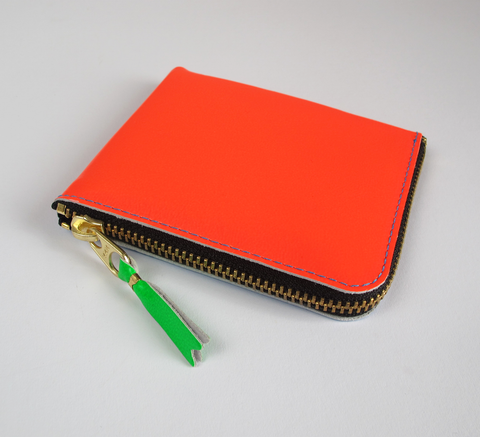 The Zip Wallet in Super Fluro is neon blue one side and orange the other... click for more information