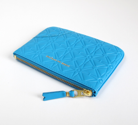 Available in a new pattern! The Zip wallet in embossed blue is a simple ... click for more information