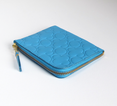 The Zip Wallet in embossed blue leather opens across two sides featuring... click for more information