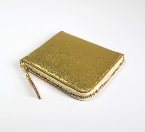 The Zip Wallet in plain gold leather opens across two sides featuring a ... click for more information