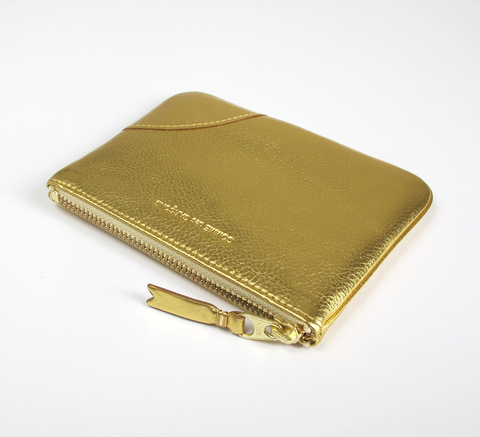 The Zip wallet in gold leather is a simple pouch with a complimentary g... click for more information