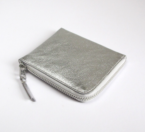 The Zip Wallet in plain silver leather opens across two sides featuring ... click for more information