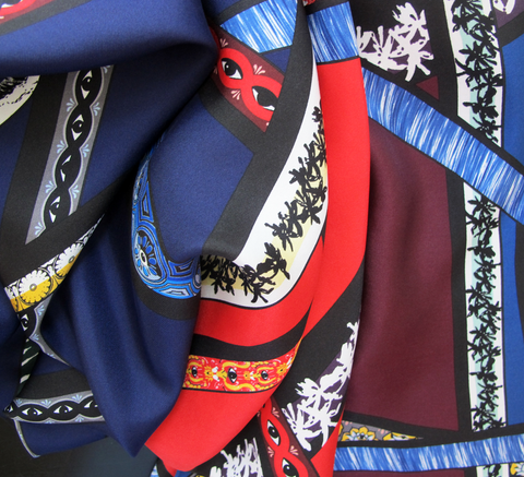 An updated design, the Kenzo Ribbons scarf features the brand's new icon... click for more information