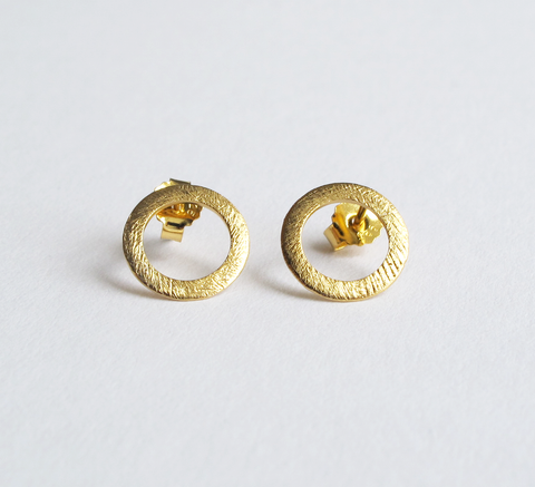 The burnished texture of the Small Open Coin earrings adds an interestin... click for more information