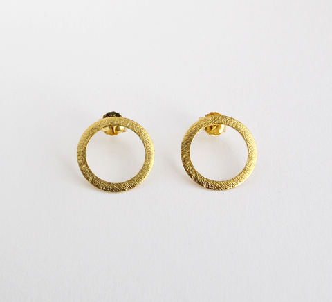 The burnished texture of Open Coin earrings adds an interesting detail t... click for more information