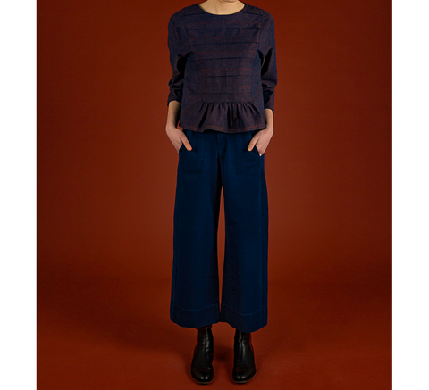 The Wonder Trousers are a high-waisted indigo design with a wide leg and... click for more information