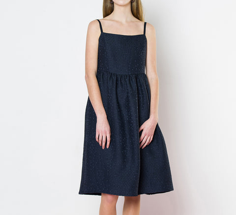 Made in New Zealand, the Rosette is a midi-length dress with a gathered ...                        click for more information