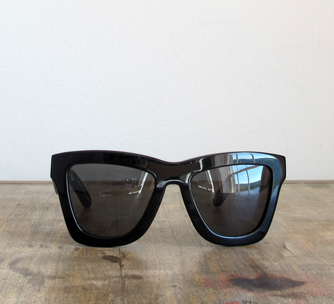 DB is an oversize unisex black frame with a black lens. The shape is fla... click for more information