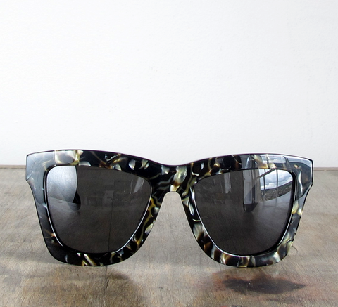 DB is an oversize unisex electric pearl frame with a black lens. The sh... click for more information