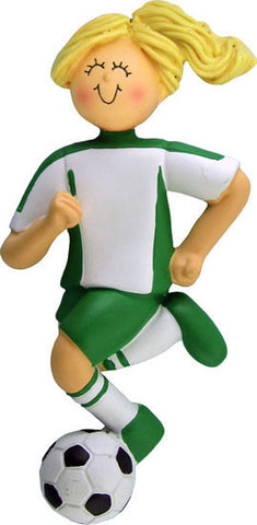 Dribbling Female Soccer Player in Green Uniform
