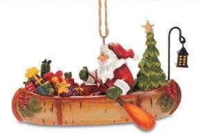Santa in Canoe Christmas Ornament