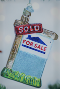 Old World Christmas Glass Realty Sign Ornament