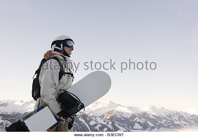 Holding a snowboard