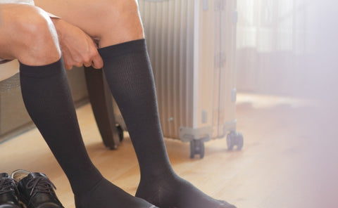 Male model wearing a pair of TXG Compression Socks