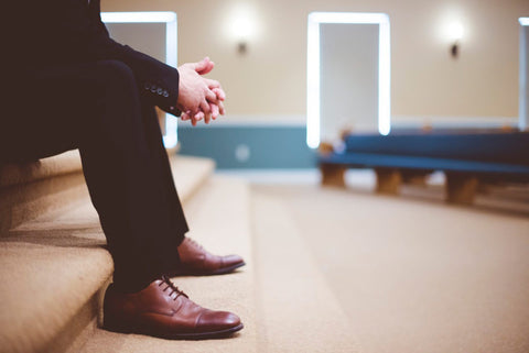 Man wearing compression socks in a waiting room