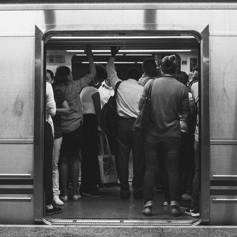 People commuting to work on a train