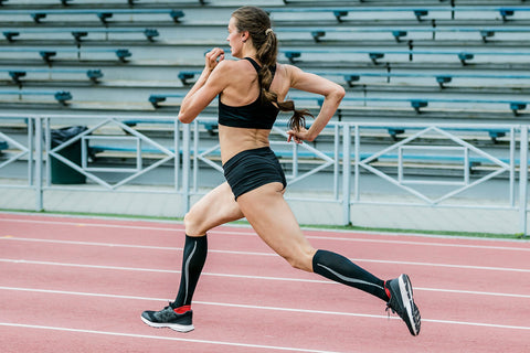 Woman sprinting wearing sports compression socks