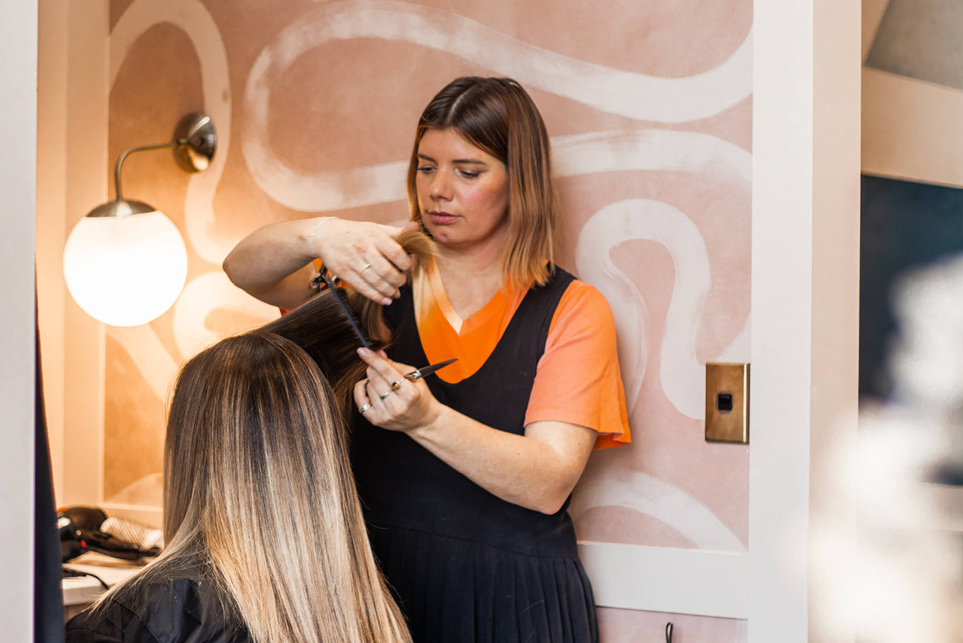 Zoe Clark of Inco Studios Hairdressing with a client