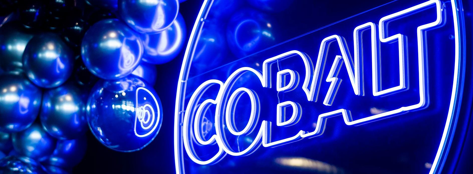 Cobalt Club gym logo in neon on the wall