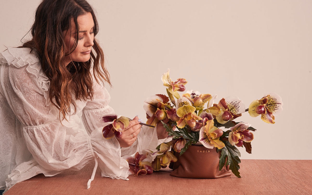 Eden Kersten head florist at The Botanist works her arrangment for Saben Primavera image project