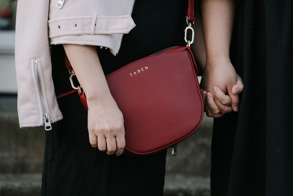 Jess Molina and her mother Florence for Saben Mothers Day campaign - close up of Sye handbag in Rosewood red leather