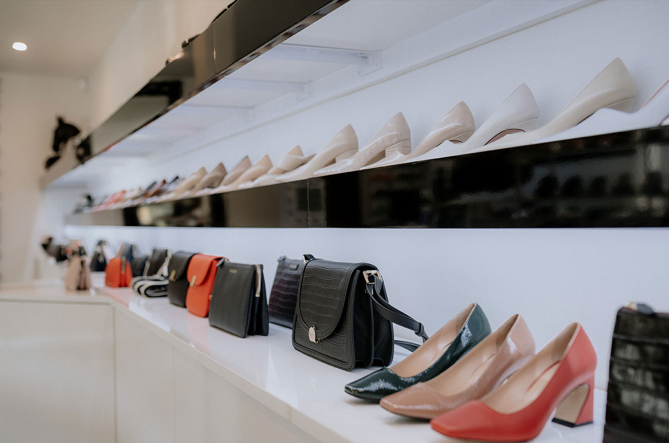 line up of leather shoes and saben hand bags at issimo christchurch