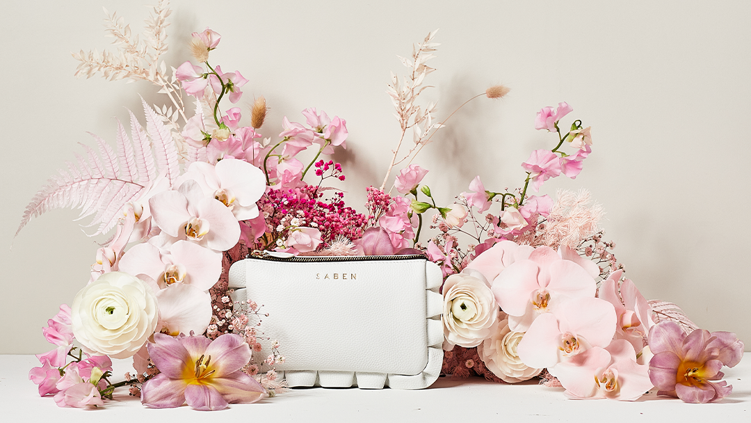 Saben Launch Bridal Collection of leather clutch purse handbag