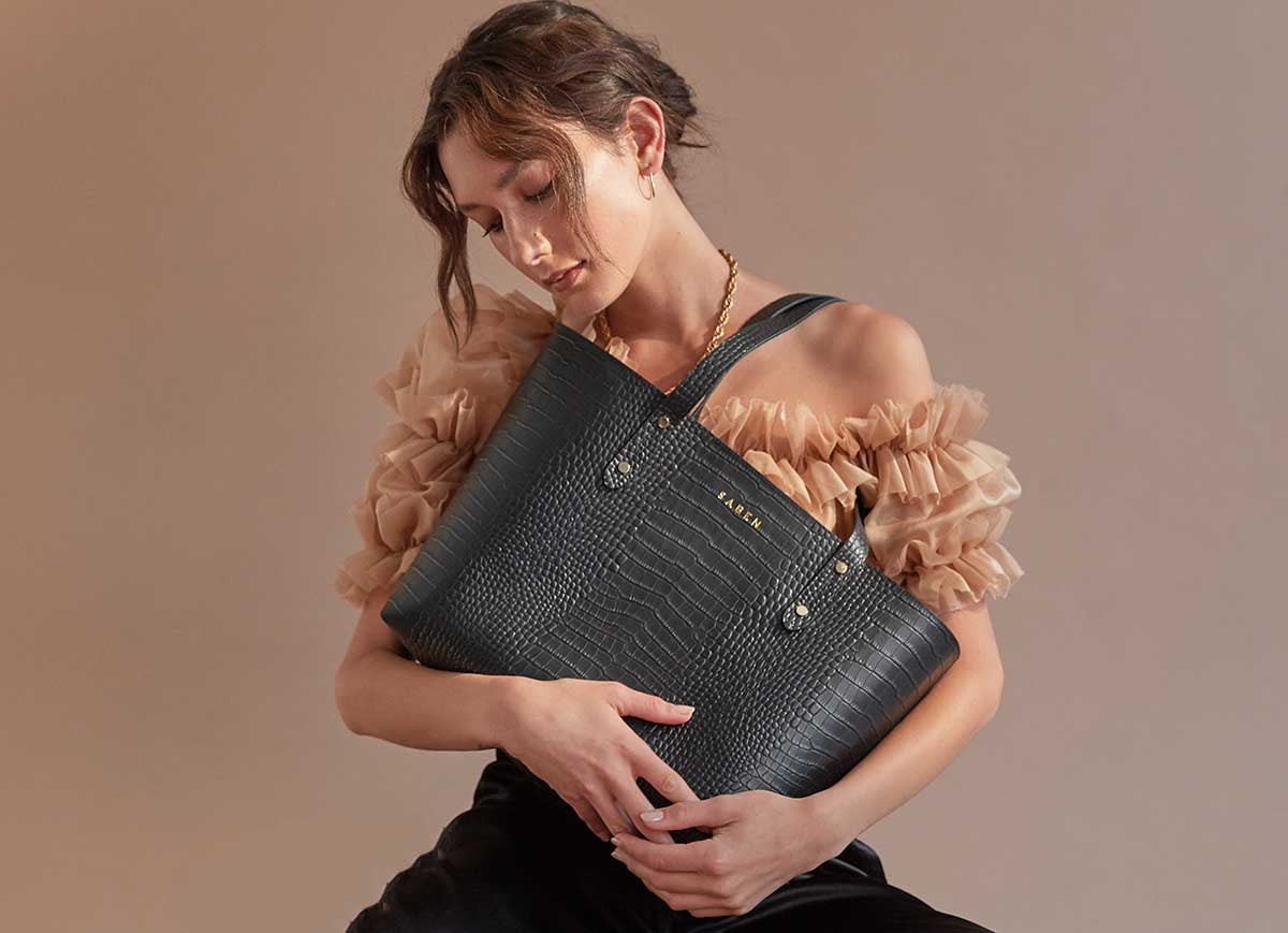 Saben launch new innovative recycled leather totes in black embossed croc worn by Manahou Mackay photographed by Mike Rooke