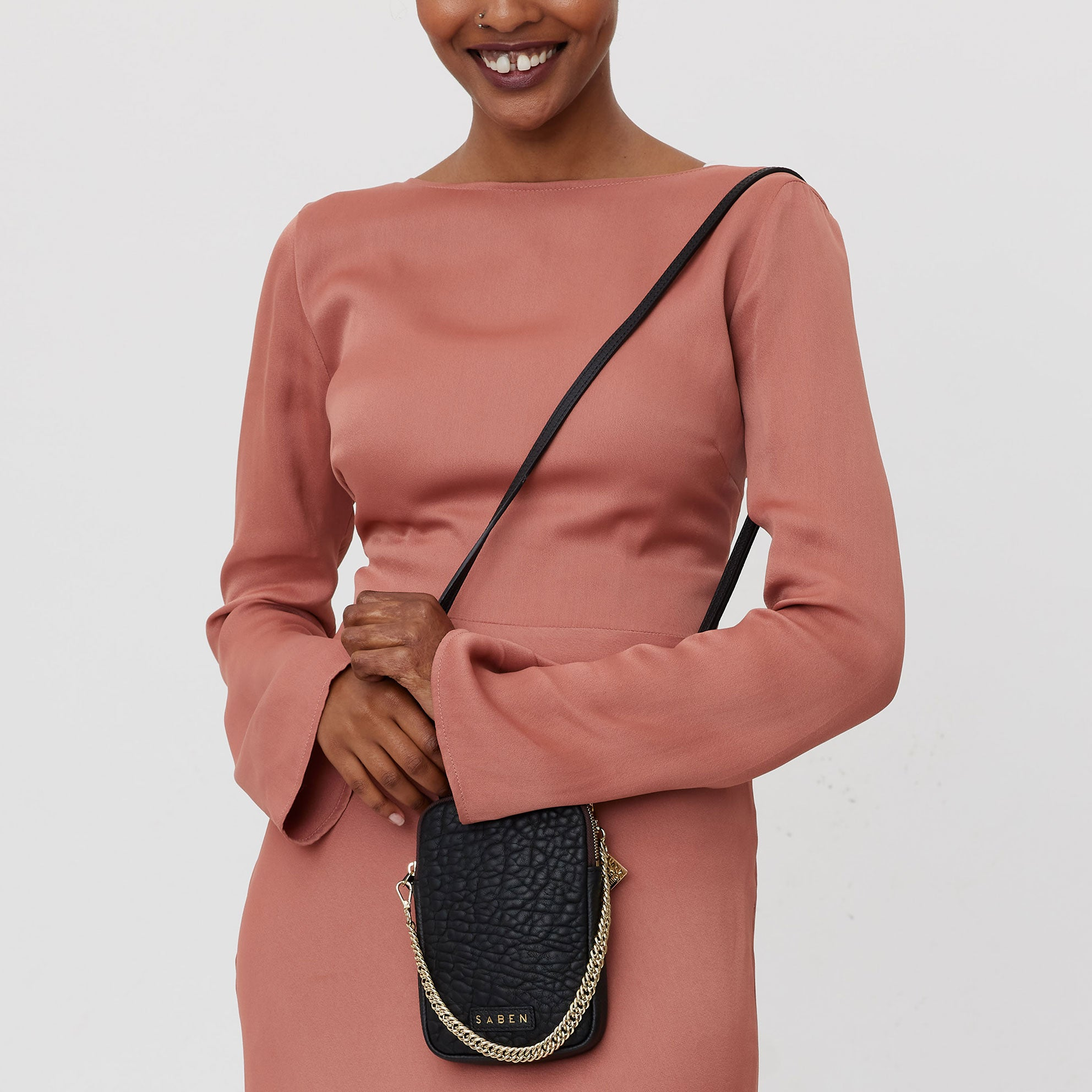 saben model wears the feature handle gold designed in New Zealandsaben handbag feature handle is designed in New Zealand and a perfect accessory for any handbag