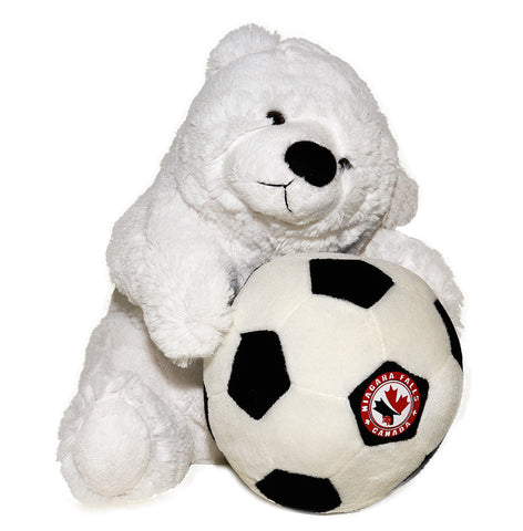 White stuffed polar bear holding a soccer ball with Niagara Falls logo on it
