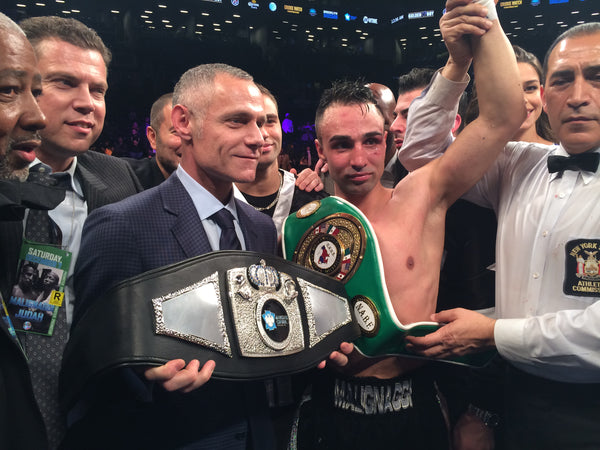 "Barclays Center CEO, Brett Yormark awarding ""Brooklyn's World Champion"" belt made by SARTONK to Paul Malignaggi"