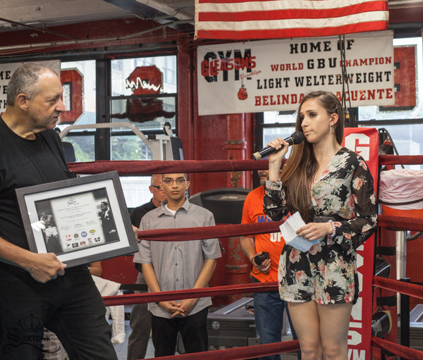 ©SARTONK. Erika Lombardi making her speech after receiving SARTONK's Ali-King Award. To her right, Bruce Silverglade, owner of Gleason's Gym. Photo credit: Hasmig Tatiossian