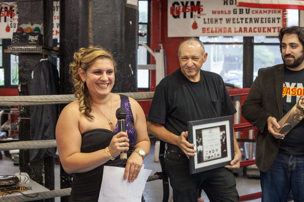 ©SARTONK. Barbara Greely making her speech after receiving SARTONK's Ali-King Award. To her left, Bruce Silverglade, owner of Gleason's Gym and Ed Majian, President of SARTONK. Photo credit: Hasmig Tatiossian