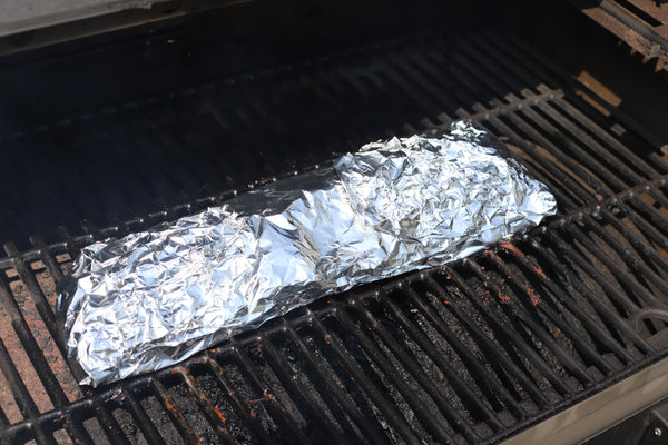wrap ribs in foil and smoke for 2 hours