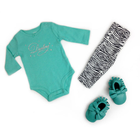 """Darling"" onesie, zebra pattern pants and aquamarine baby moccasins"