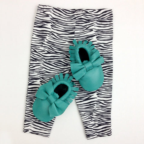 zebra pattern pants and aquamarine baby moccasins