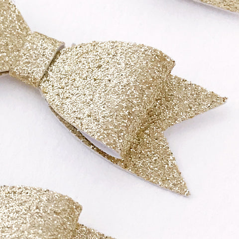 detail of mini gold paper glitter bow
