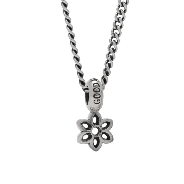 photo of the cutout Rosette pendant on a curb chain #1 necklace.