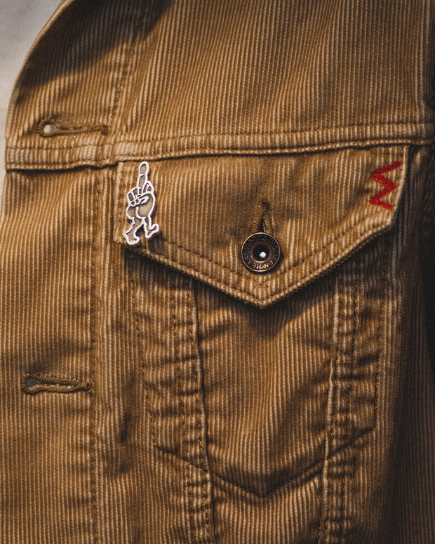 The Buster pin shown on a jacket pocket.