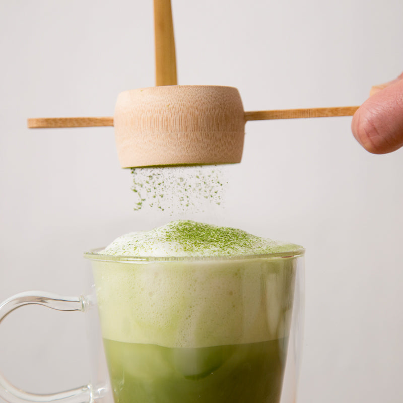 Matcha powder: sift and sprinkle Encha organic matcha on latte