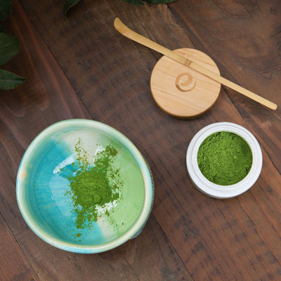 scoop organic matcha powder from jar to matcha bowl Encha